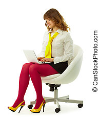 Girl in a bright dress with a laptop