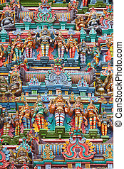 Sculptures on Hindu temple gopura (tower). Menakshi Temple,...
