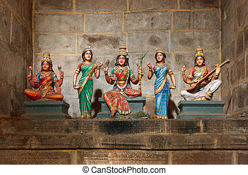 Hindu goddesses Parvati, Lashmi and Saraswati statues in...