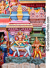 Shiva and Parvati on bull image. Sculptures on Hindu temple...