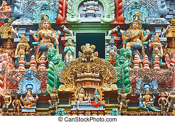 Sculptures on Hindu temple gopura (tower). Jambukeshwarar...