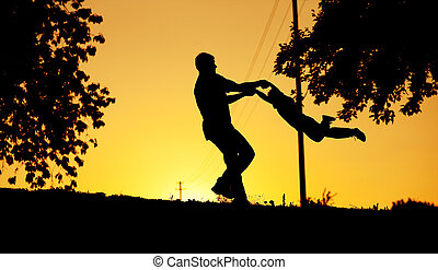Father and son playing at sunset - Father and sun playing at...
