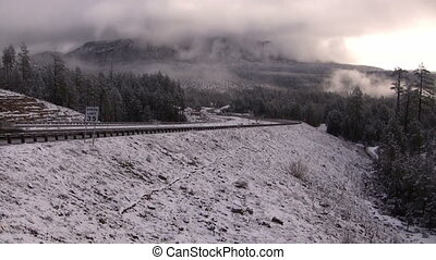 White Mountains snow car - Car traveling on a freshly plowed...