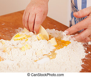 Baking biscuits - Woman mixes dough - Baking biscuits, woman...