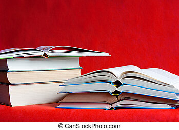 many different books are on a red  background