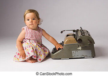 Baby Girl Posing with Typewriter