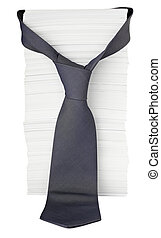 stack of papers and tie onoffice desk