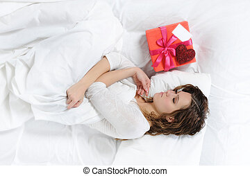 young woman with a gift box