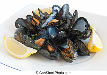 dish with mussels - cooked mussels on a plate with lemon...