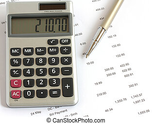 calculator pen and finances - calculator and pen on...