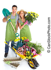 Gardening People workers with flowers Isolated over white...
