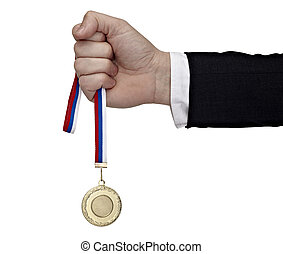business hand holding golden medal - close up of a...