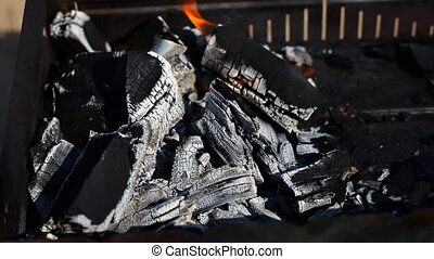 Charcoal BBQ - Charcoal burns to the embers in a grill.