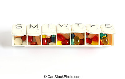 seven day pill box with pills isolated on white background