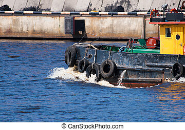 tugboat - small tugboat float in river with blue water