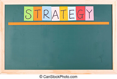 Strategy, colorful word on blank blackboard
