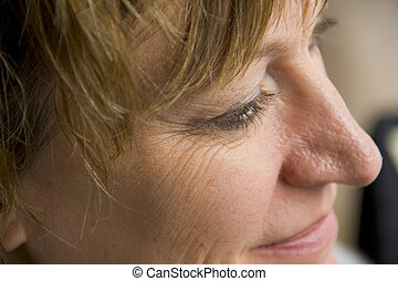 Close up of womans wrinkles - Close up portrait of woman...