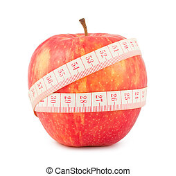 Red apple and measure tape - Tape measure wrapped around the...