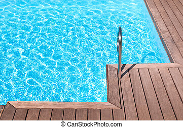 Pool side - Fragment of a swimming pool and wooden floor