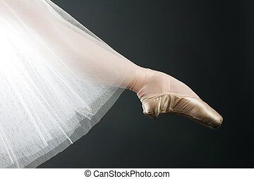 legs in ballet shoes on a black backgrounde