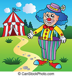 Clown in big pants with circus tent