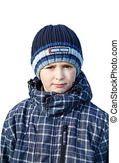 Small boy dressed to winter cloth isolated on white