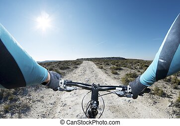 mountain bike - forefront of the handlebars of a bicycle on...