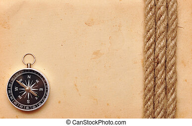 compass and rope on old paper