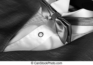 Bow tie with tuxedo and shirt