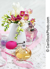 Vintage perfume bottles and flowers on the table