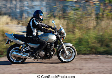 man riding a motorcycle on the road - Acctive man riding a...