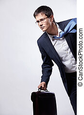 Businessman running - A young man running with a briefcase