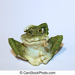 ceramic frog on white background - a funny ceramic frog...