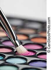eyeshadow set with makeup brush picking up color