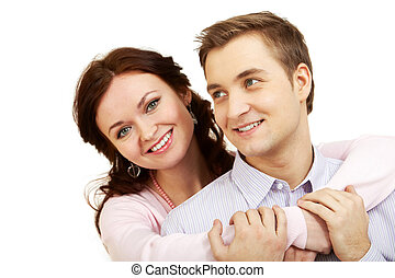 Young happy couple - A young girl embracing her boyfriend,...