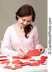 Saint Valentines day - Portrait of a woman signing valentine...