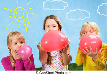 Inflating - Photo of three cute girls inflating balloons