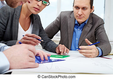 Sketching - Three businesspeople sitting at table and...