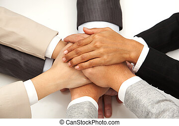 Symbol of partnership - Image of eight hands clutched...