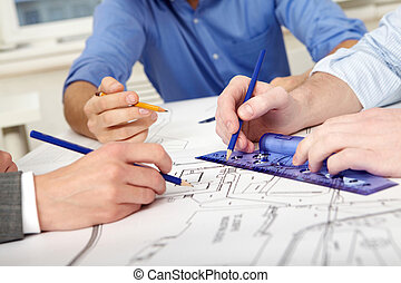 Inventing process - Close-up of three engineers? hands...
