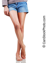 Sexy legs - Beautiful sexy girl in a jeans short isolated on...