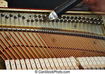 Tuning up the piano - Tuning the piano by adjusting the pegs