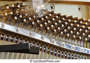 Tuning a piano - Tuning the piano by adjusting the pegs