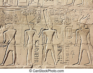 ancient egypt images and hieroglyphics on wall in karnak...