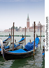 Blue and black gondolas on Grand canal Venice Italy