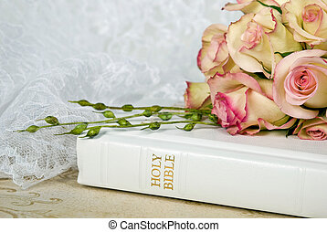Wedding Bible - Rose bouquet on white Bible.
