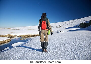 winter hiking woman - woman at Gredos mountains in Avila...