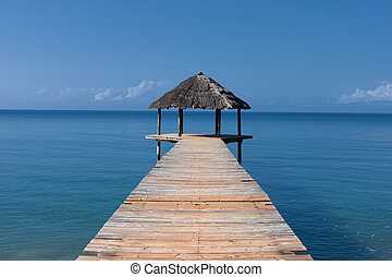 Pontoon - Hut on the background of ocean on the island of...