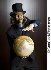 Man with gas mask and globe - Businessman wearing a gasmask...