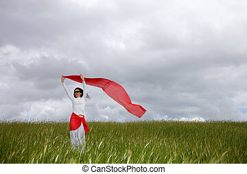 red scarf - beautiful young woman on field with a red scarf